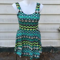 Tribal print skater dress Stand out in a crowd with this neon and tribal print skater dress! Slight pilling. Price reflects this. Size tag missing, best suited for XL. Ultra Flirt Dresses Mini
