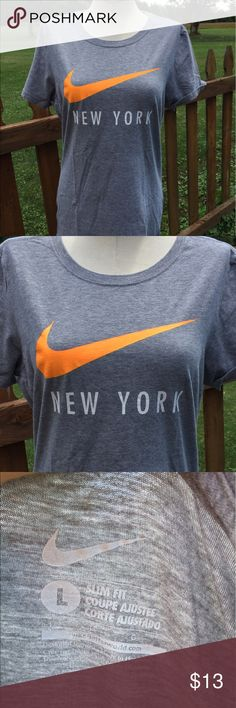 Nike New York Slim Fit Shirt Size Large Size large. Slim fit. Super gently preowned. Be sure to view the other items in our closet. We offer  women's, Mens and kids items in a variety of sizes. Bundle and save!! We love reasonable offers!! Thank you for viewing our item!! Nike Tops Tees - Short Sleeve