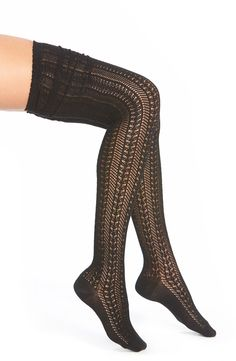 Pairing these cozy thigh-high socks with a pair of knee high boots.
