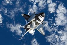 Space Shuttle Discovery approaches the International Space Station during STS-120 rendezvous and docking operations. NASA Image.
