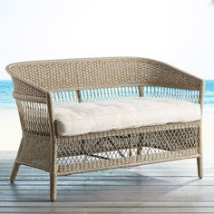 """Handcrafted by skilled artisans, our Everly Settee is hand-woven of synthetic wicker over a rust-resistant metal frame. Stackable for off-season storage, it is a perfect example of versatile furniture designed for outdoor entertaining.<span id=""""mini-upsell"""" data-launch=""""true"""" data-required=""""false"""" data-product=""""Cushions"""" data-masters=""""PV285-1:2;PV200-25:1""""></span>"""