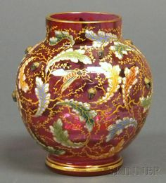 Enameled Glass Vase with Acorns  Possibly Ludwig Moser, Carlsbad, late 19th/early 20th century  Translucent cranberry glass with allover enameled and gilt trailing oak boughs and insects, with applied silvered acorns