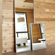 METAL FLOOR MIRROR. This tall, clean-lined design comes in brushed-nickel and works perfectly leaned against a wall.