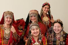 Stock Photo Turkmenistan, Group picture of Turkmen family in tradtional costume