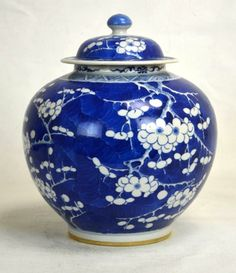 "Chinese Blue & White Globular Ginger Jar decorated on exterior and lid with a cherry blossom motif. Blue double circle on bottom. Height without lid - 8 1/2"" Qing Dynasty"