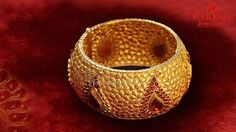 Gold bangle designs with red stones. For more stone bangle collections, check our complete catalogue.