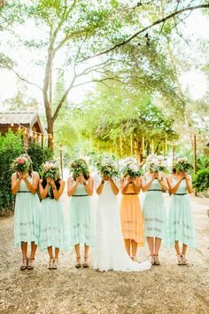 Turquoise and light orange. Love the colors and dresses...but why are thy hiding their faces?