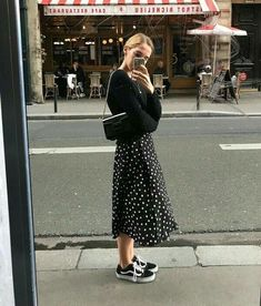 Black and white polka dot skirt outfit with black sweater and vans sneakers fall winter skirt outfit street style