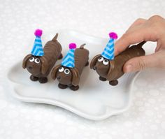 These candy canines are so doggone cute - made with twix bars and Hershey's Kisses!! @followcharlotte