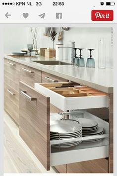 Love the clean white slab & wooden cabinets