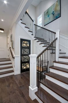 The staircase features White Oak wood treads and custom wrought iron spindles. The staircase features White Oak wood treads and custom wrought iron spindles. Wrought Iron Staircase, Staircase Railings, Staircase Design, Staircase Ideas, Banisters, Iron Spindle Staircase, Stair Case Railing Ideas, Iron Railings, Dream Houses