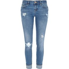 Mid wash ripped Daisy slim jeans $84.00