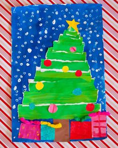 paint paper (green, blue & colors with patterns), tear green in strips and cut out colors for ornaments and presents