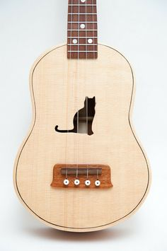 Ukulele (customizable sound hole of choice) Example: Cat ($400.00) - Svpply