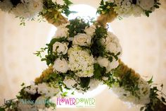 The central top point of the floral mandap.