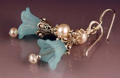 These EXQUISITE beauties were made using the loveliest frosted lucite aqua lilies, ornate Sterling Silver, and creamy white fresh water