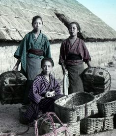 An informal portrait in a Japanese village, circa 1890's. Photographer K. Tamamura.