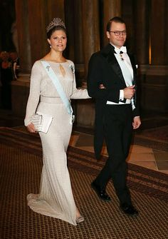Crown Princess Victoria and her husband Prince Daniel. The future queen of Sweden radiated in a silver gown, which featured a thigh-high slit and a keyhole neckline.