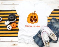 Items similar to Pumpkin Shirt Unisex Tee Gift for Halloween Xs Brown Spooky Black on Etsy Halloween Season, Your Best Friend, Trick Or Treat, Cool T Shirts, Creepy, Pumpkin, Unisex, Group, My Style