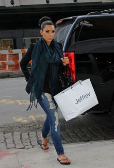 Kim Kardashian wearing HELMUT LANG TWIST BURGUNDY top Balenciaga Classic Part Time Bag Havaianas Slim Flip Flops in Grey