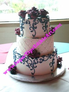 @Rhonda White  I like this, but with different flowers. My colors too :) Buttercream Wedding Cake Teal and Maroon
