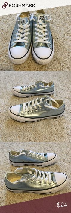 EUC Converse Chucks Size 7 Womens Metallic Blue These chucks have been worn twice!! They are just a little small for me but I loved the color and bought them anyway! These were purchased at Von Maur and are the coolest light metallic blue!!! Excellent condition Converse Shoes Athletic Shoes