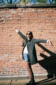 Coat: Alexa Chung for MadewellJumper: Alexa Chung for MadewellShorts: Vintage Levi'sBoots: ChanelBag: Chanel