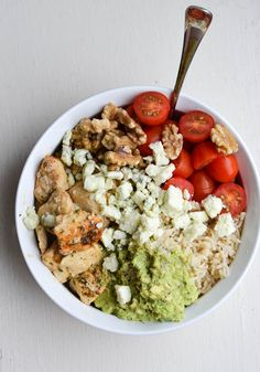 CHICKEN & AVOCADO RICE BOWLS with tomatoes, lime and blue cheese. I can dig this