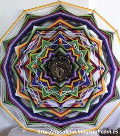 Force and wisdom,  Yarn Mandala / Ojo de Dios, by RusaLena.via Etsy. This is beautiful!