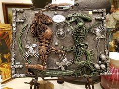 Steampunk Alien vs Predator by Sycophantic Work displayed at the Kalifano off the Las Vegas Strip