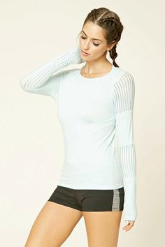 A knit top featuring mesh cutouts on the sleeves, long raglan sleeves, a round neckline, ribbed trim, and moisture management.