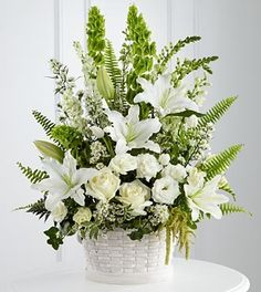 The FTD® In Our Thoughts™ Arrangement is a symbol of pure peace and caring kindness. White roses, tulips, freesia, Oriental lilies, double lisianthus, Monte Casino asters and snapdragons are beautiful
