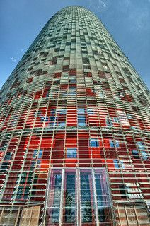 VERY bad move, Barcelona (colored glass does NOT an architecture make). And WTF does this building have to do with the Barcelona that we knew and loved . It is a TRAGEDY of a grand order. Interesting Buildings, Amazing Buildings, Modern Buildings, Amazing Architecture, Contemporary Architecture, Architecture Design, Gaudi, Jean Nouvel, Begur Costa Brava