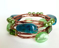 Set of 4 wire wrapped bangles.  Great for a May birthday!