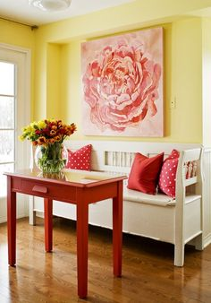 red home accents A side table, repurposed from a guest room, was updated in cheery red for this kitchens eating nook and paired with an oversized floral painting and colourful throw pillows. Yellow Paint Colors, Yellow Walls, Yellow Painting, Yellow Rooms, Colours, Yellow Home Decor, Interior Decorating, Interior Design, Decorating Ideas