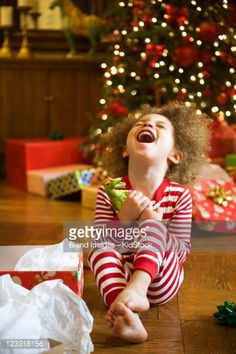 Stock Photo : Excited mixed race boy opening Christmas gift