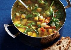 Root and vegetable chowder with shredded collard greens.