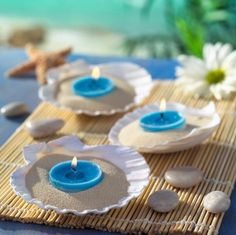 An evening in the tropics or a brunch in Nantucket. Lovely and could not be easier. we love this.  The shells are often available at local craft stores and plates of this shape can be found at party stores.  A little beach sand and blue tea lights or blue votive candles. We also have Mega Tea Lights which would be a great, longer burning alternative.  Check out the assortment and find your color at www.BeverlyHillsCandle.com