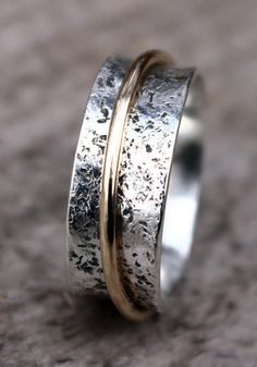 Hammered Sterling Silver Spinner Ring, Wedding Ring, Narrow Spinner Ring, with Gold Spinner 925 Argentium Sterling, by Mountain Metalcraft https://www.etsy.com/listing/164175032/hammered-sterling-silver-spinner-ring