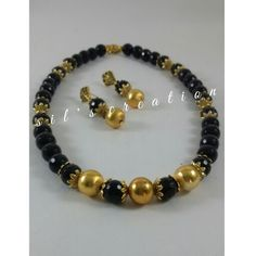 Black agates with antique caps an beads.