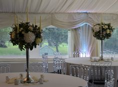 Candelabra's made from white hydrangea, White O'Hara roses, Mentha Rose and Avalanche roses. Created by Eden Blooms at Russets County House wedding venue Caper Berries, Blooms Florist, Country House Wedding Venues, Centerpieces, Table Decorations, Hydrangea, Wedding Flowers, Lisa, Roses