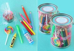 "Small paint can pails (available from Oriental Tradding Company, or Michael's) were filled with mini colored pencils, bubbles in a crayon shaped container, an erasser, a rainbow lollipop (from Party City), and multi color crayon ""pods"" I made from broken, melted crayons"