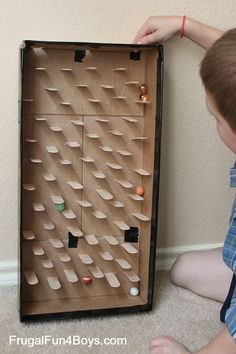 Build a marble run with craft sticks. Great craft activity for rainy days.