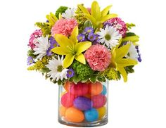 What a cute idea! Good way to use those little plastic eggs to make a nice Easter center piece.