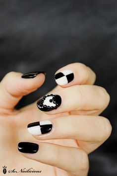 3D black & white nail art with beaded heart