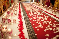 Red carpet aisle with white rose petals. Photo by www.rhmphotography.com