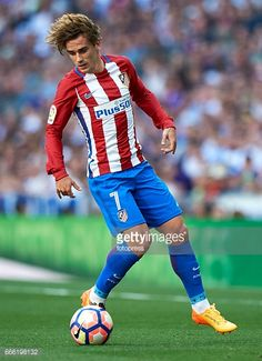 Antoine Griezmann of Atletico de Madrid in action during the La Liga match between Real Madrid CF and Atletico de Madrid at Estadio Santiago Bernabeu on April 8, 2017 in Madrid, Spain.