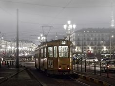 Midnight train in the fog - Turin, Italy. Photo by Chema Ocaña