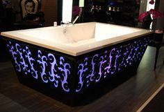 Rectangular bathtub with purple lighting ~ my boyfriend says he can make something like this for me when we have a bathroom big enough ~sigh~