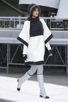 Everything shimmered and shined - the little tweed suits and sets sprinkled with silver tinsel, later sequin constellations orbiting black eveningwear. There were bags that doubled as muffs and the...